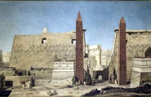 Obelisco diante das ruinas do Templo de Louxor