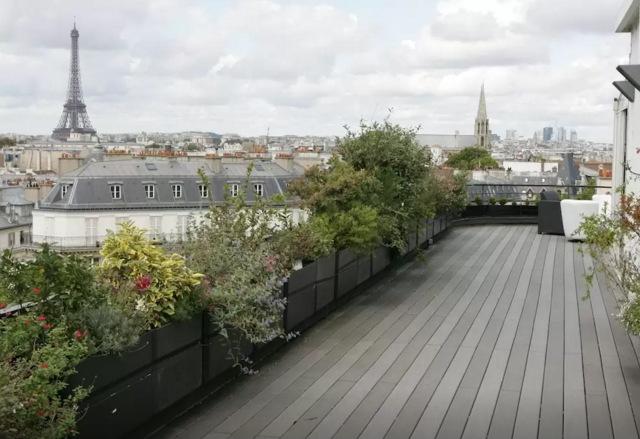 Terraço de 100m2 com vista para os telhados de Paris e os principais monumentos da cidade